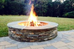 Outdoor patio installation of fire pit in Glenelg