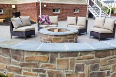 Pation installation with retaining wall and fire pit in Sykesville