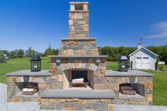 Outdoor patio design in Glenelg with fireplace