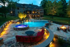 Outdoor patio installation with landscape lighting