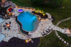 Backyard with pool, and landscape lighting