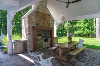 outdoor patio installation in Sykesville with eating space and outdoor kitchen