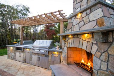 Outdoor patio installation with outdoor kitchen and fireplace