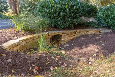 Water drainage retaining wall hardscaping
