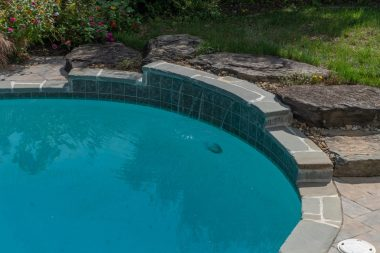 Landscape design in Glenwood MD, pool near raised ground with steps