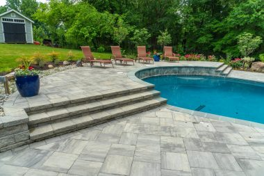 Outdoor patio design, pool, and steps in West Friendship