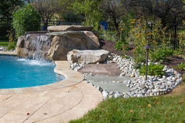 Water feature by pool with Hardscaping in Sykesville