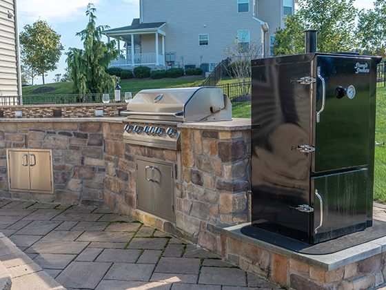 Outdoor patio installation with grill and smoker